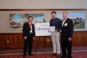Jie Feng accepting his poster award, sponsored by Greenheck